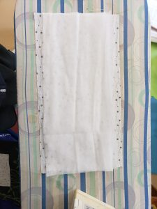 Backing fabric with 4 layers of polypropylene remay cloth layered on for washable filter lining